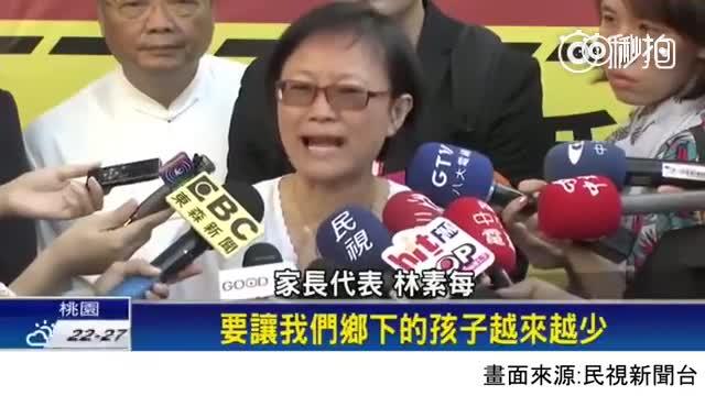 台湾一段对反同性婚姻人士的采访,旁边记者的表情实在太