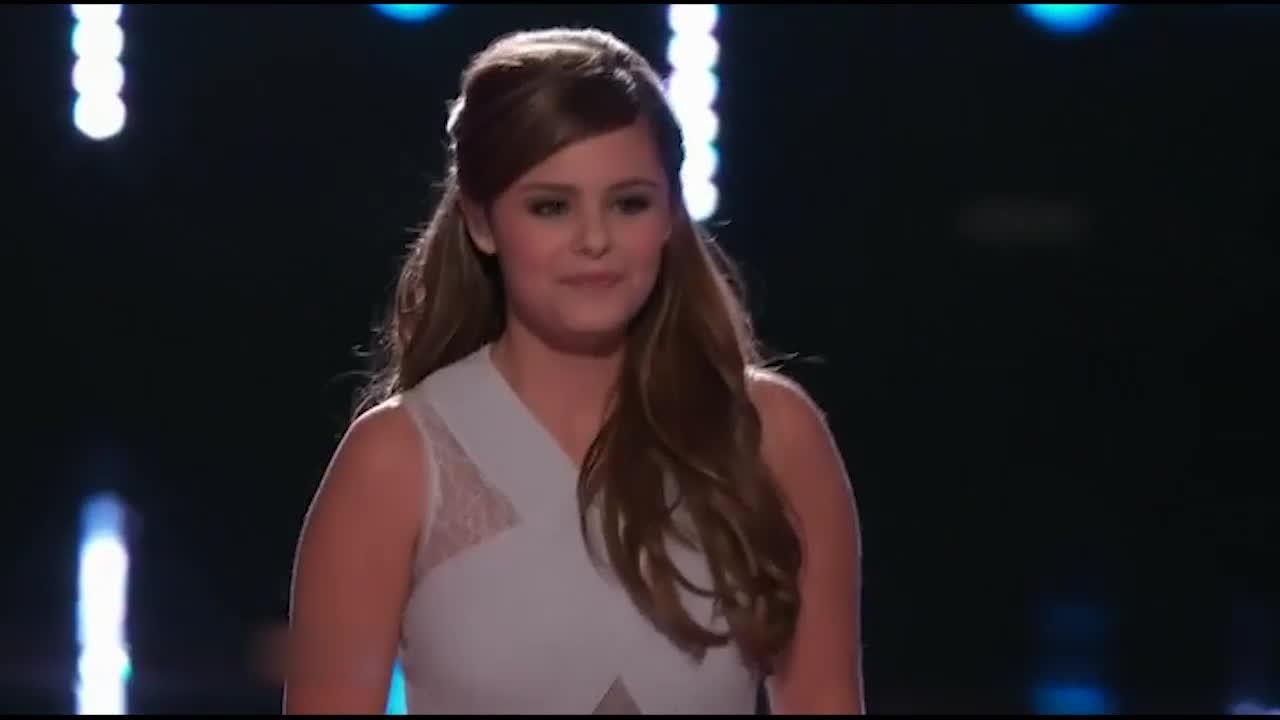 她不仅唱好了这首歌,还唱出了歌曲表达的感情